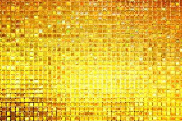 Glanzend geel goud gebrandschilderd glas textuur achtergrond