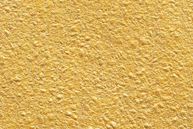 Glanzend goud getextureerde papier achtergrond