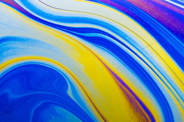 Glanzende golvende blauwe en gele abstracte achtergrond