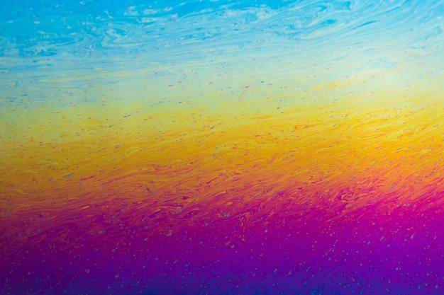 Glanzende golvende paarse blauwe en gele abstracte achtergrond