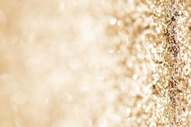 Glanzende gouden glitter achtergrondstructuur