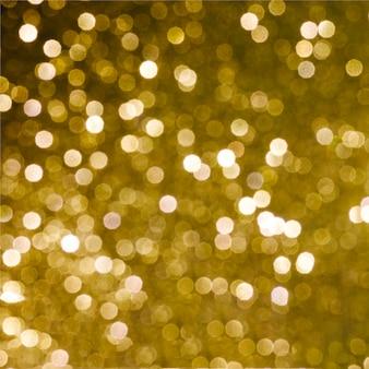 Glanzende gouden lichte achtergrond