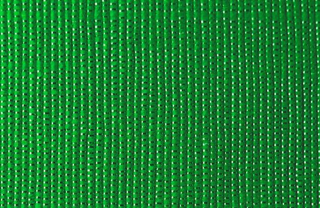 Glanzende groene stoffentextuur
