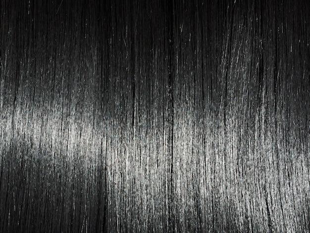 Glanzende rechte zwarte haarachtergrond. mooi zacht donkerbruin haar