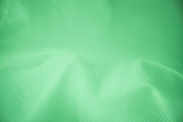 Glanzende vloeiende doektextuur in macroschot.