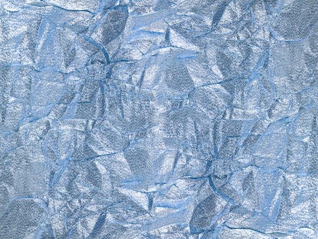 Glanzende zilveren blauwe textielachtergrond