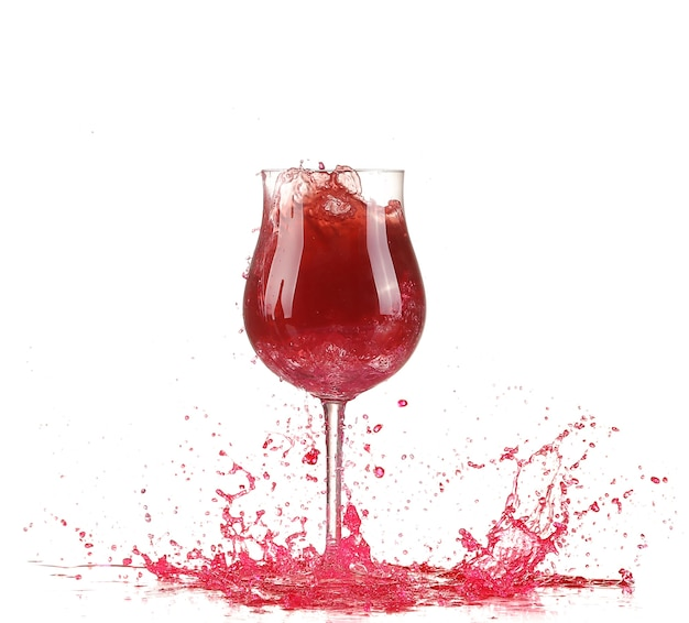 Glas met rode wijnplons