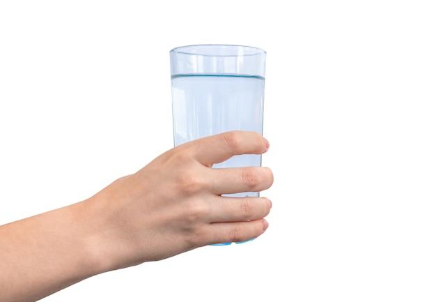 Glas vers water in de hand geïsoleerd op een witte achtergrond photo