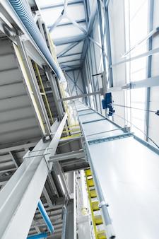 Glasvezel productie-industrie apparatuur bij fabricage achtergrond