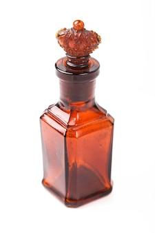 Glazen bruine retro fles met stopkroon