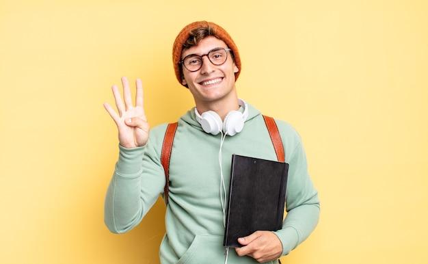 Glimlachend en vriendelijk kijkend, nummer vier of vierde tonend met de hand naar voren, aftellend. studentenconcept