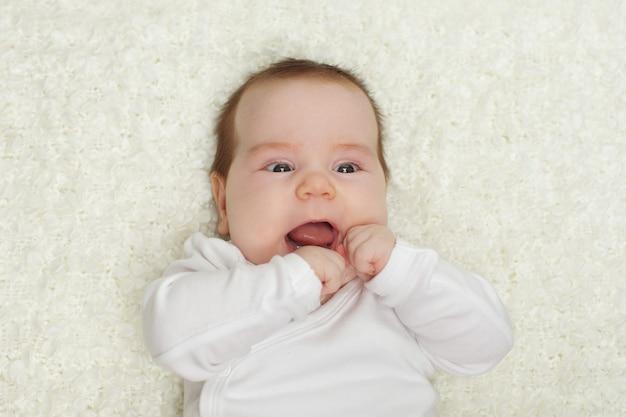 Glimlachende baby (tot drie maanden)