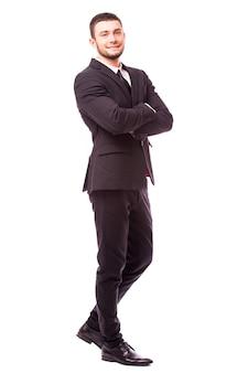 Glimlachende knappe zakenman. geïsoleerd over witte muur