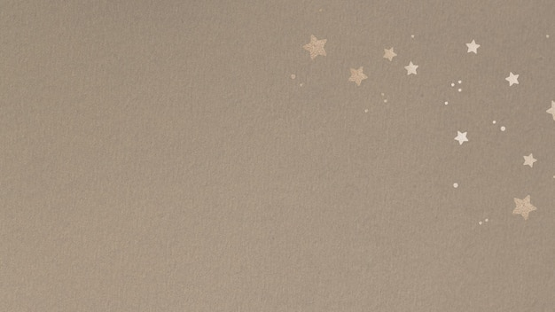 Glinsterende gouden sterren op een beige achtergrond