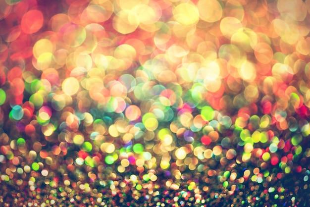 Glitter gouden bokeh kleurrijke wazig abstracte achtergrond voor verjaardag, jubileum, bruiloft