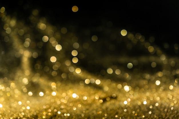 Glitter lichten grunge achtergrond, goud glitter intreepupil abstract twinkly lights achtergrond.