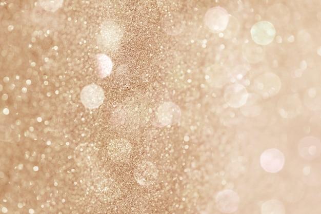 Glittery gouden bokeh patroon achtergrond afbeelding
