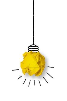 Gloeilamp gemaakt van een geel papier bal