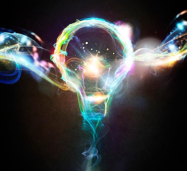 Gloeilamp getekend met kleurrijke lichteffecten