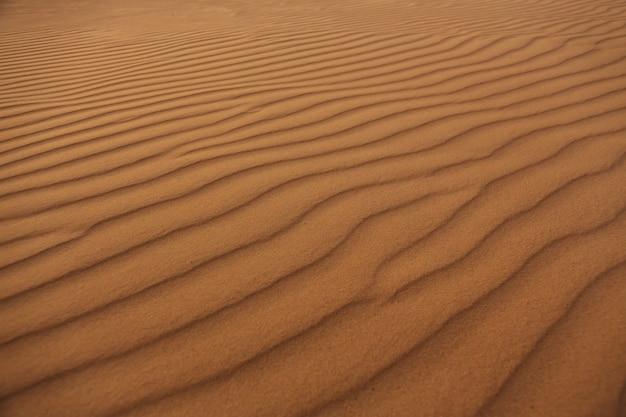Golven van zand textuur, duinen van de woestijn.