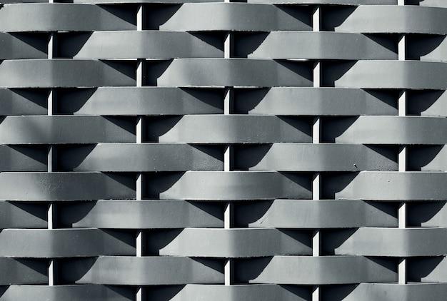 Golvend ijzer grijs patroon als achtergrond of textuur