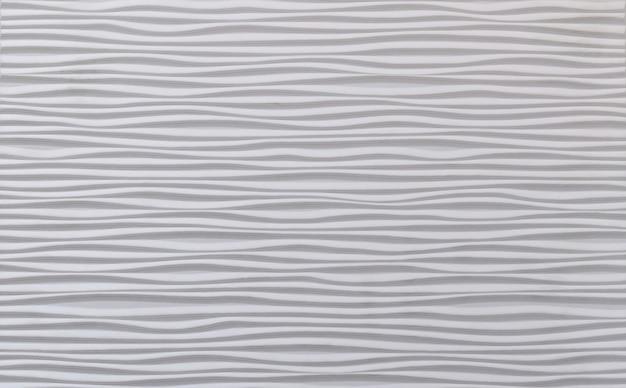 Golvende achtergrond. streeptextuur met veel lijnen. golvend patroon. lijn kunst. grijze en witte afbeelding