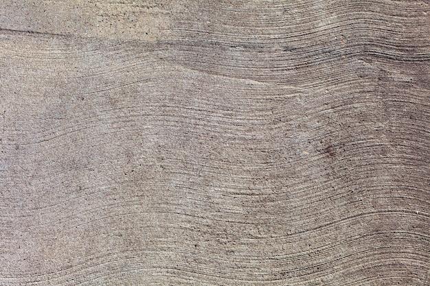 Golvende lijnen grijze betonnen textuur, golvende lijnen