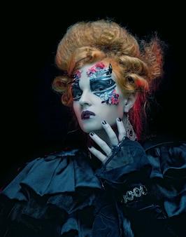 Gotische heks met halloween make-up