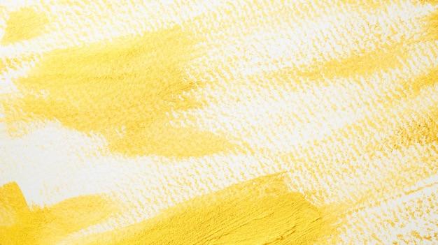 Goud gekleurde affichewaterverf op witte achtergrond.