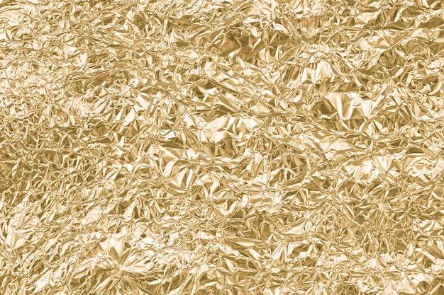 Goud gerimpeld papier textuur abstracte achtergrond