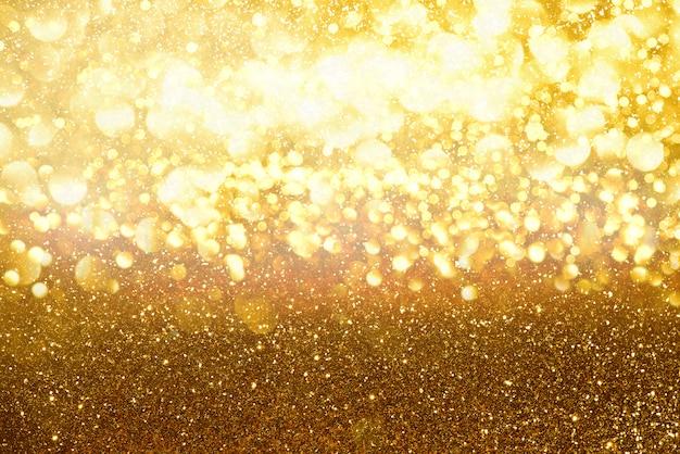 Goud glitter licht textuur bokeh abstracte achtergrond. defocused