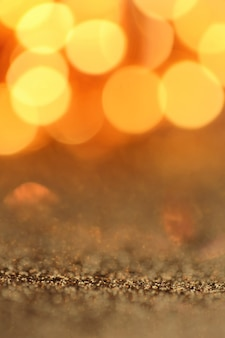 Goud glitter macro achtergrond met glanzende gele bokeh