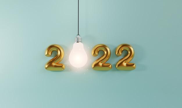 Gouden 2022 jaar ballon met gloeilamp gloeien op blauwe achtergrond voor 2022 idee door 3d render techniek.