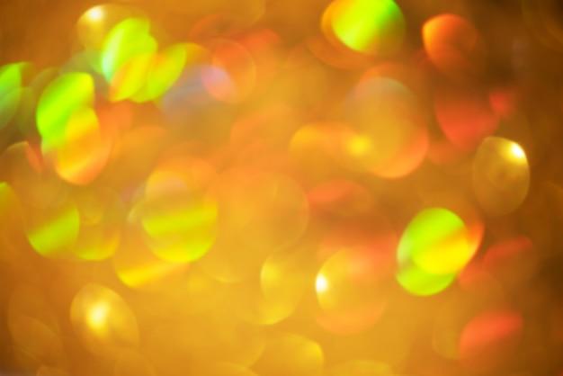 Gouden abstracte achtergrond. defocus licht schittert van gouden kleur als achtergrond voor ontwerpers.