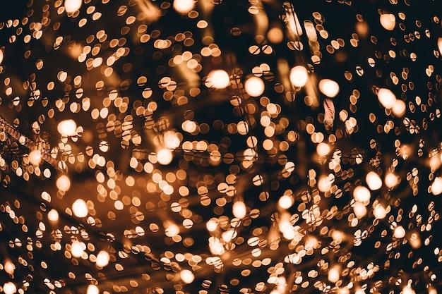 Gouden abstracte bokeh lichtenachtergrond. defocused