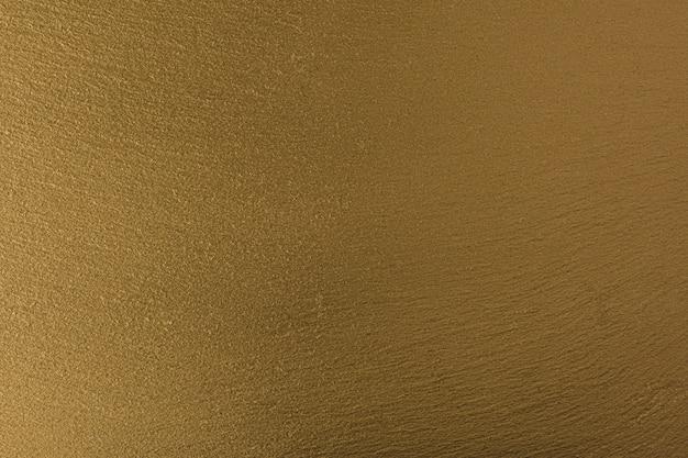 Gouden achtergrond, goudbruine mosterdkleur, natuursteen