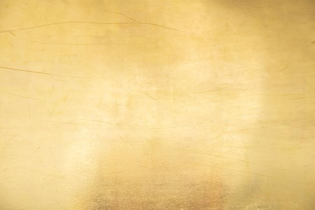 Gouden achtergrond of textuur en gradiënsschaduw.