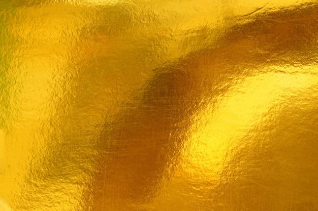 Gouden achtergrond of textuur en schaduw van verlopen
