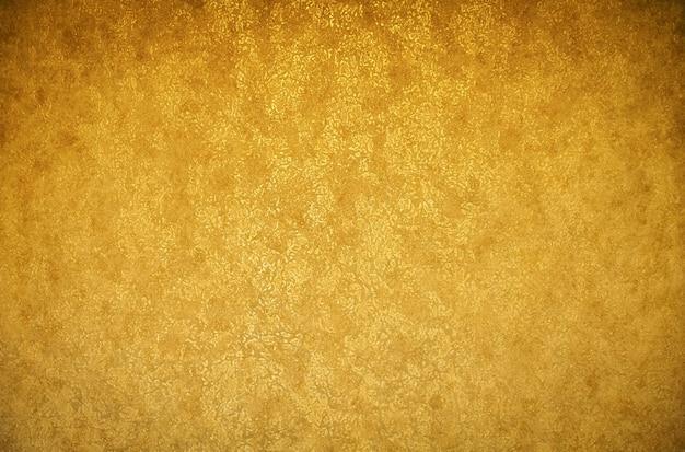 Gouden achtergrondstructuur. behang op de muur. ontwerpelement.