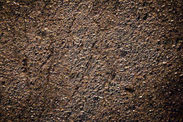 Gouden asfalt textuur achtergrond.