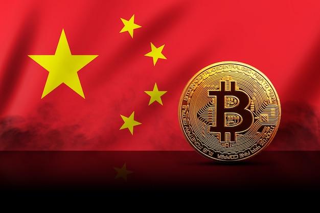 Gouden bitcoin munt op de achtergrond van de chinese vlag. cryptocurrency-concept