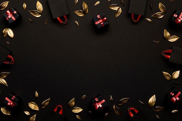 Gouden bladeren en boodschappentassen kopiëren ruimte