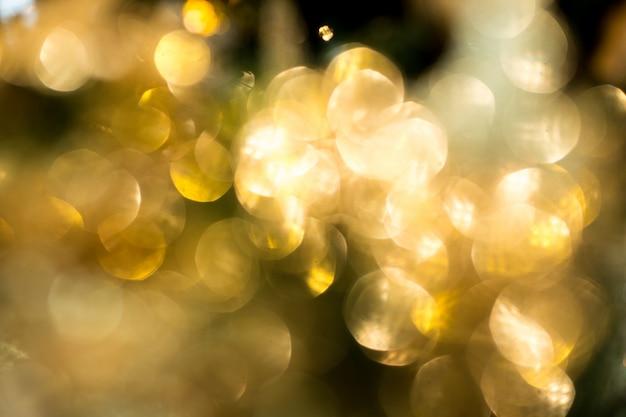Gouden bokeh in kerstmisberoemdheden