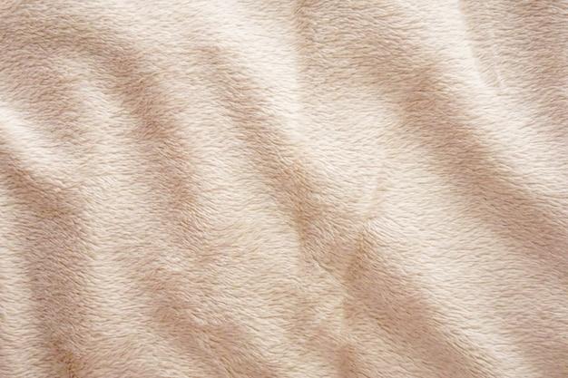 Gouden bruine achtergrond van het de textuurmalplaatje van de stoffen abstracte natuurlijke wol.
