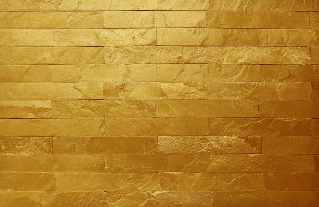 Gouden de muurtextuur van de leisteen in natuurlijk patroon met hoge resolutie voor achtergrond.