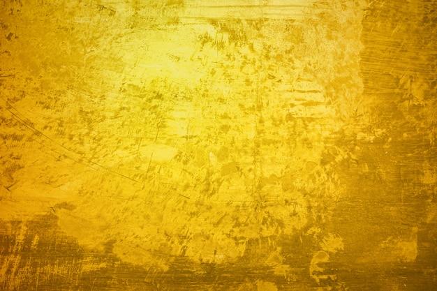 Gouden de oppervlaktetextuur van de muurverf voor achtergrond