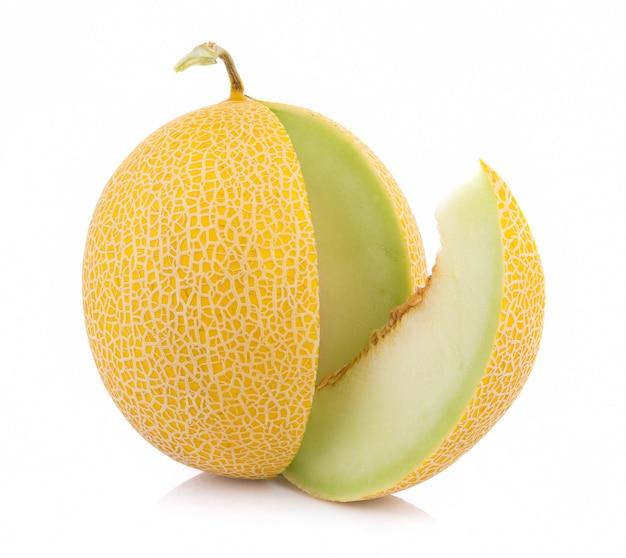 Gouden die kantaloepmeloen op witte achtergrond wordt geïsoleerd