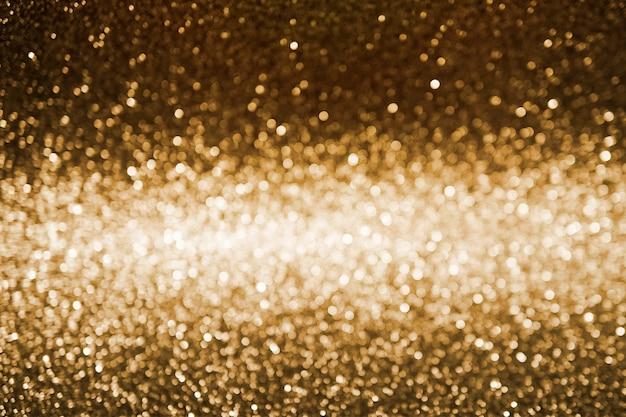Gouden donkere abstracte bokeh achtergrond