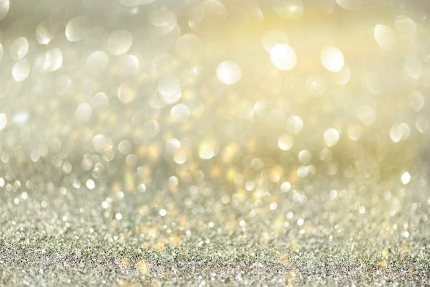 Gouden en zilveren abstracte bokehlichten.