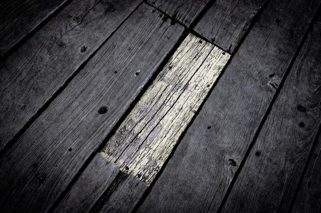 Gouden en zwarte houten textuurachtergrond